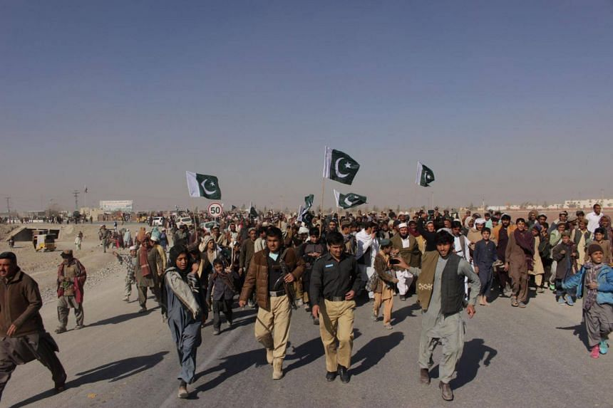 Pakistani demonstrators gather during a protest against US aid cuts at the Pakistan-Afghanistan border post in Chaman on Jan 5, 2018.