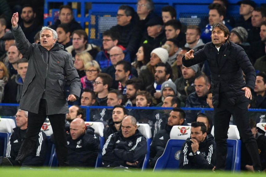 Manchester United's manager Jose Mourinho (left) and Chelsea's head coach Antonio Conte gesture on the touchline during the English Premier League football match between Chelsea and Manchester United at Stamford Bridge, London, on Nov 5, 2017.