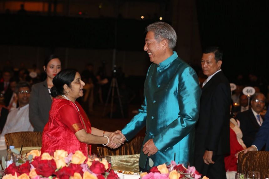 DPM Teo Chee Hean and India Minister of External Affairs Sushma Swaraj exchanging greetings at The Asean-India Pravasi Bharatiya Divas gala dinner at Marina Bay Sands, on Jan 7, 2018.