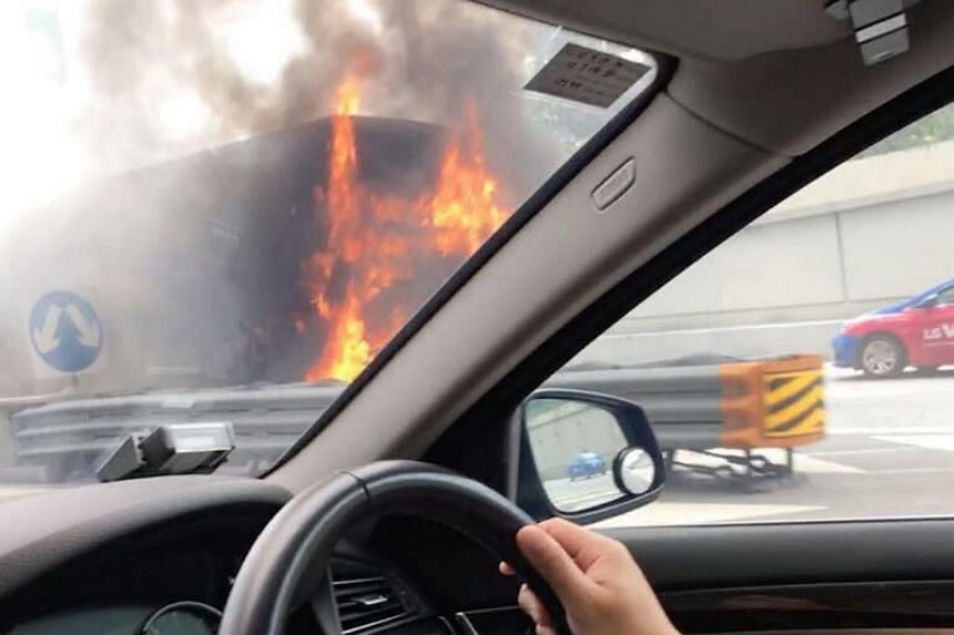 A private bus caught fire along the MCE near the East Coast Parkway (Changi) exit on Jan 7, 2018.