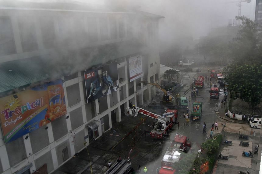 Firefighters battling a fire that broke out in a shopping mall in Cebu city on Jan 6, 2018.