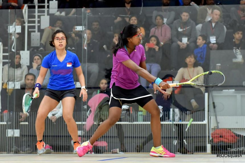National squash player Au Yeong Wai Yhann (left) in action during her quarter-final loss against top seed Sivasangari Subramaniam of Malaysia at the British Junior Open on Friday.