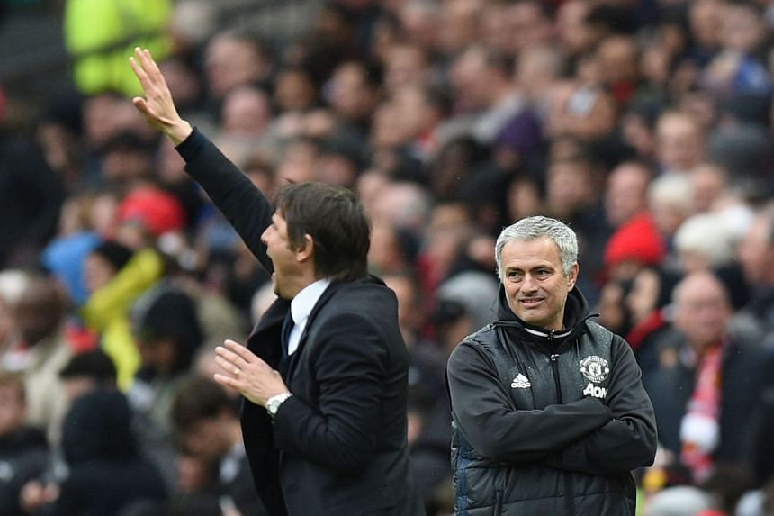 Mourinho looks on as Chelsea coach Antonio Conte gestures during a match against United in April 2017.