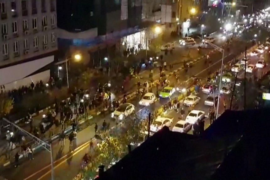 Protesters down a street in Tehran on Dec 30, 2017. More than a week of unrest in Iran has seen 22 people die and more than 1,000 arrested.