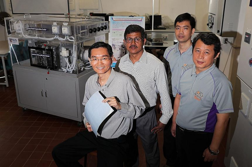 (From far left) Associate Professor Ernest Chua, 48, holding a membrane sheet used in the Membrane Dehumidification Module; Dr Md Raisul Islam, 52, senior lecturer; Dr Bui Duc Thuan, 37, research fellow; and Dr M Kum Ja, 47, senior research fellow be