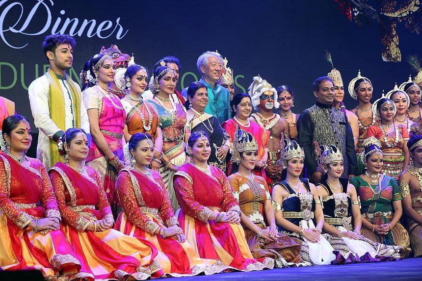 Deputy Prime Minister Teo Chee Hean and (beside him, in red) Indian Foreign Minister Sushma Swaraj with performers at the gala dinner last night for the Asean-India Pravasi Bharatiya Divas conference.