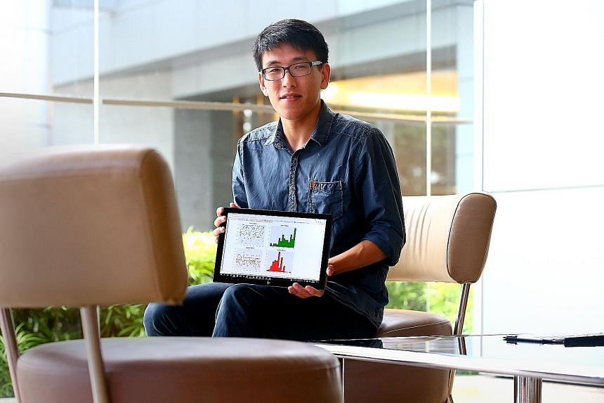 NUS law and economics student Jerrold Soh with a prototype of his simulator program, which he developed together with three of his peers. Using an algorithm, the program predicts the division of matrimonial assets in a divorce case.