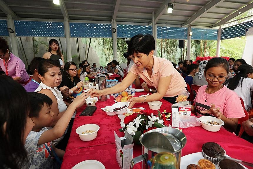 Senior Minister of State for Finance and Law Indranee Rajah at the launch of a programme yesterday to provide breakfast for children living in rental blocks in Tanjong Pagar GRC, which she represents as an MP.