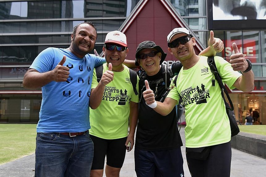 (From far left) Mr Vijay Kumar, organiser of the walk, with participants Ong Chin Bok, Steven Chee and Alex Quah, who completed the full 100km yesterday. More than 150 people participated in the event, with 27 making it to the 50km mark at Waterway P
