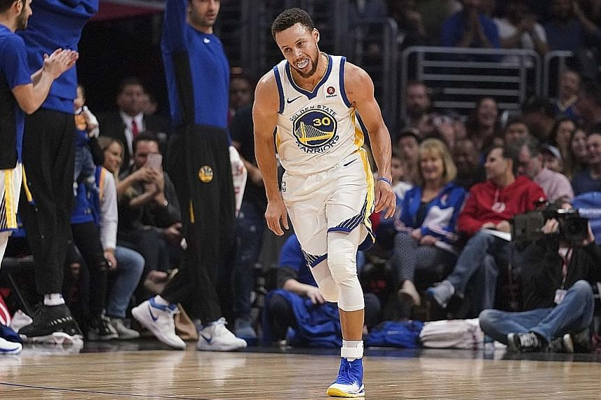 Golden State Warriors guard Stephen Curry celebrating after one of his eight three-pointers against the Los Angeles Clippers at Staples Centre on Saturday. He made a career-high 15 of 16 free-throws for a season-high 45 points.