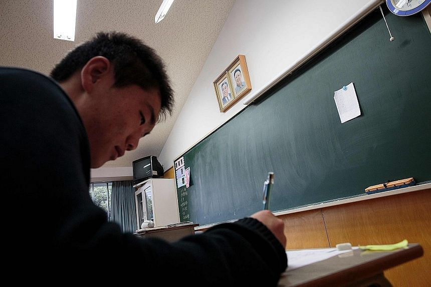 A student at the Korean High School in Tokyo. One of the good practices to adopt for better learning is to direct your attention to just one or two tasks at a time, says the writer. That generally means no background music - it will not help you lear