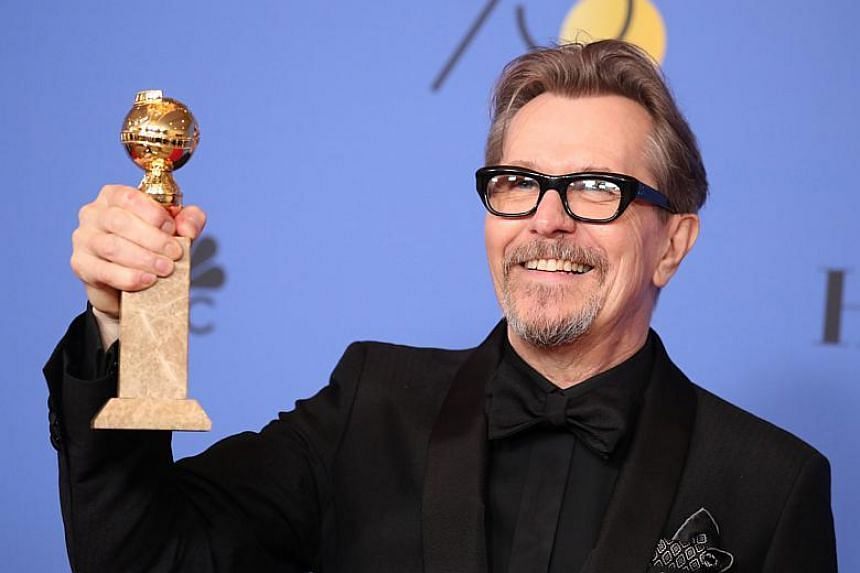 Gary Oldman poses backstage with his award for Best Performance by an Actor in a Motion Picture - Drama for Darkest Hour.