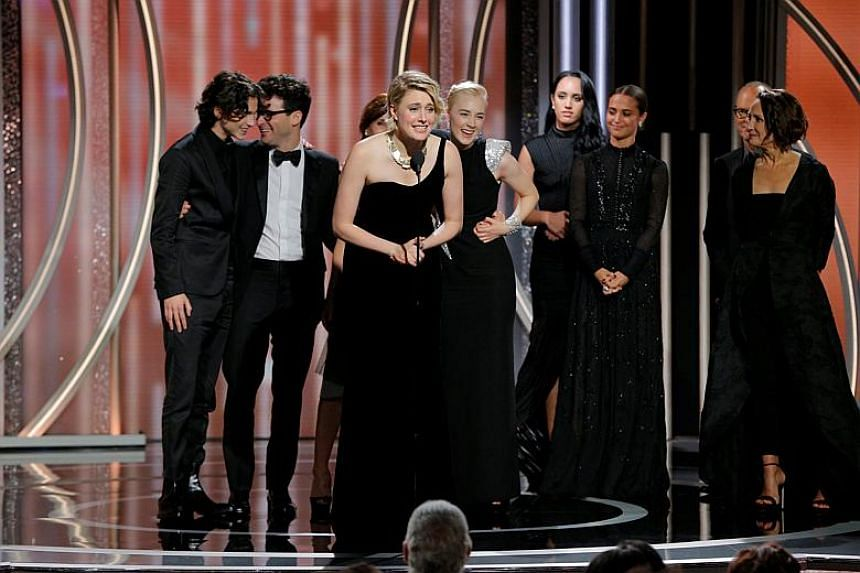 Greta Gerwig director of Lady Bird accepts the award for Best Motion Picture Comedy or Musical at the 75th Golden Globe Awards.