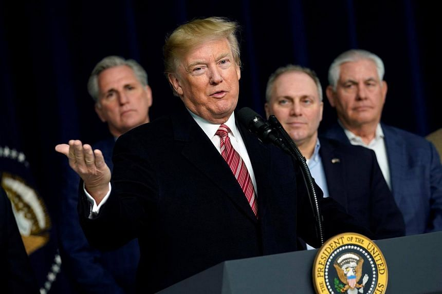 US President Donald Trump speaks to the media after the Congressional Republican Leadership retreat, on Jan 6, 2018.