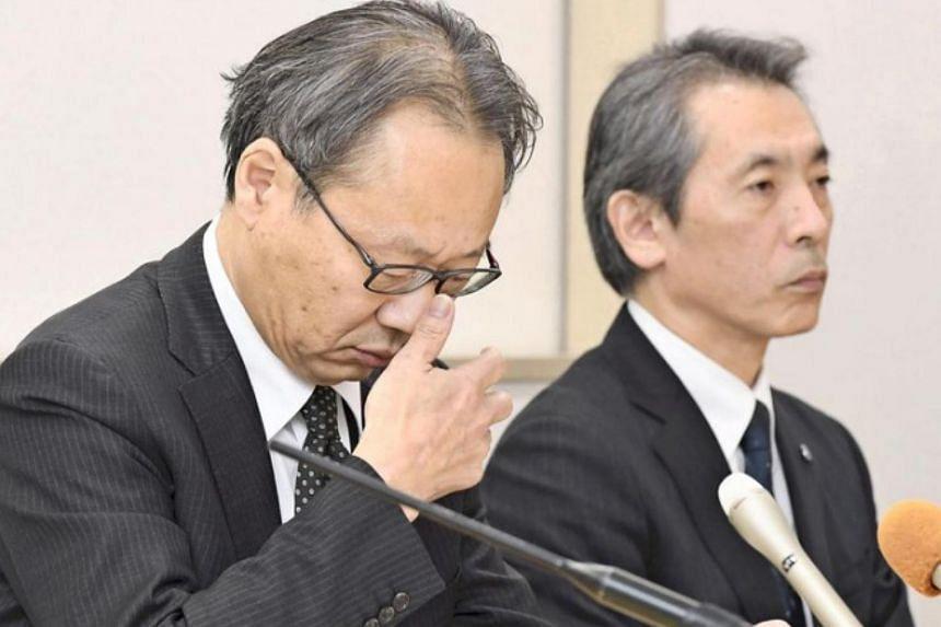 Osaka University executive vice-president Tadashi Kobayashi (left) speaking during a press conference in Suita, Osaka prefecture, on Jan 6, 2018.