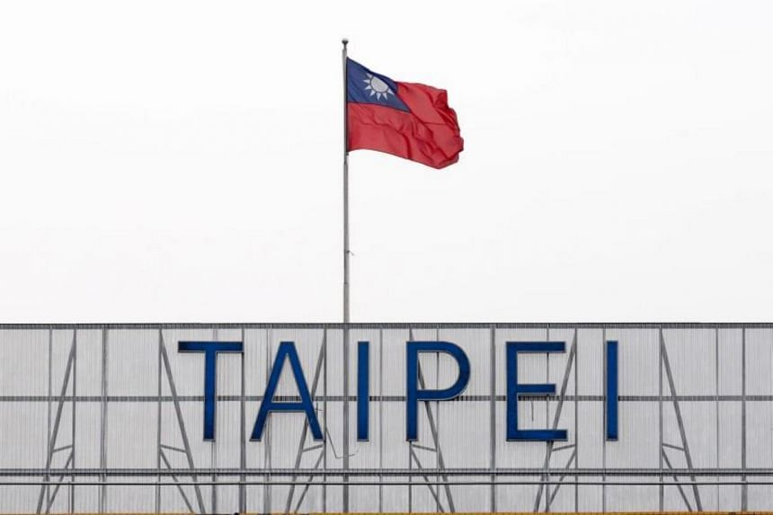Taiwan's national flag flies at the Taipei Songshan Airport in Taipei. Taiwan has protested China's four flight routes in the Taiwan Strait which theaten the safety of international flights.