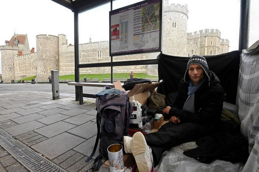Stuart, a homeless man, at the bus shelter where he sleeps opposite Windsor Castle. The wedding of Britain's Prince Harry and US actress Meghan Markle will be held in the mediaeval castle's chapel on May 19.