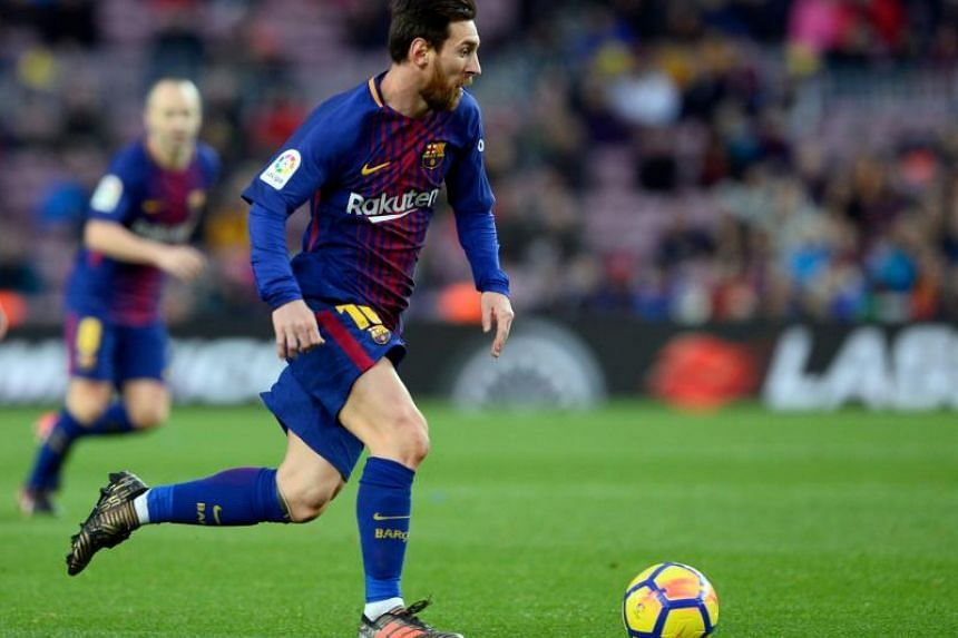 Barcelona's Argentinian forward Lionel Messi runs with the ball during the Spanish league football match FC Barcelona vs Levante UD at the Camp Nou stadium in Barcelona on Jan 7, 2018.