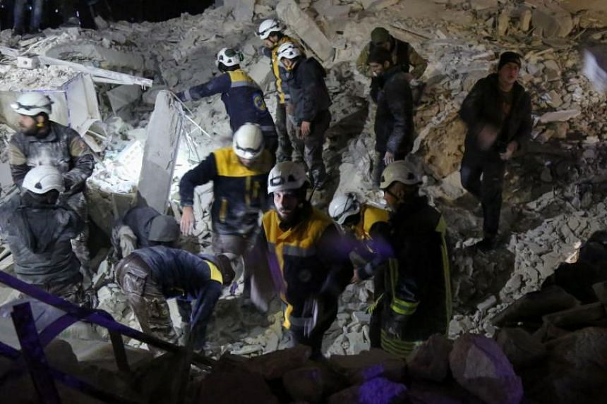 Syrian emergency personnel search for victims following an explosion in a rebel-held area of the northwestern city of Idlib on Jan 7, 2018.