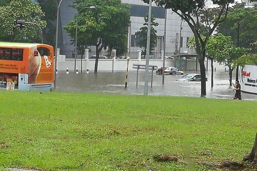 Flooding in Bedok, in front of Changi Fire Station, caused by the heavy rain.