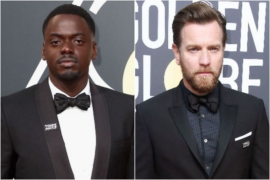The Time's Up pins seen on the lapels of actors Daniel Kaluuya and Ewan McGregor.