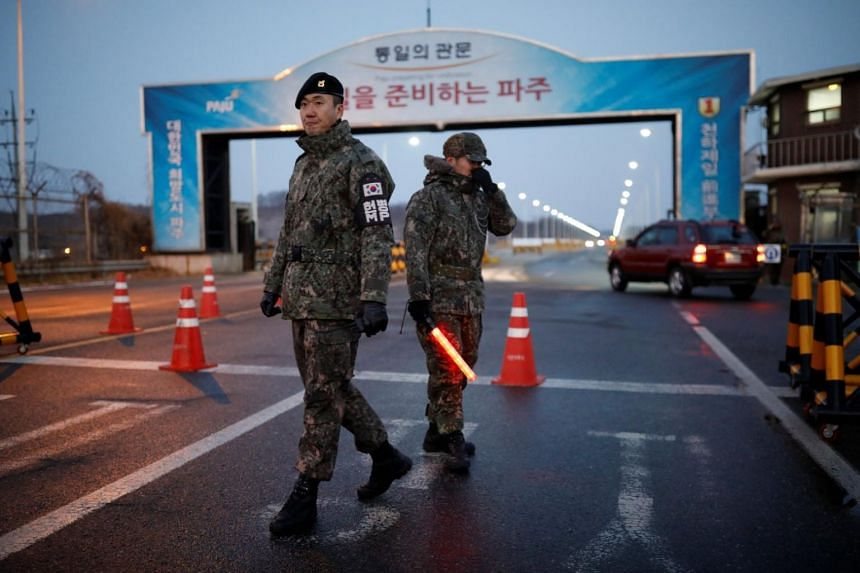 South Korean soldiers stand guard at a checkpoint on the Grand Unification Bridge that leads to the truce village of Panmunjom, just south of the demilitarised zone separating the two Koreas.
