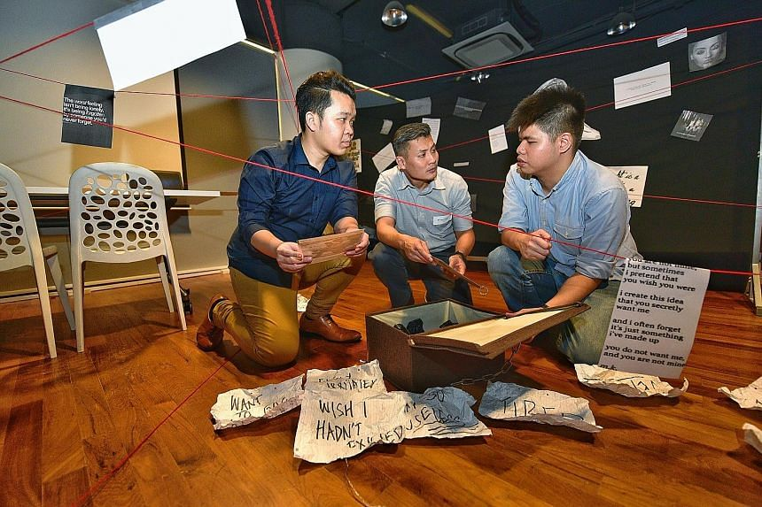(From left) Game organiser and Youth Corps Singapore leader Cho Ming Xiu, National Youth Council chief executive officer David Chua and Mr Chia Xun An, who has suffered from depression and was diagnosed with borderline personality disorder, checking