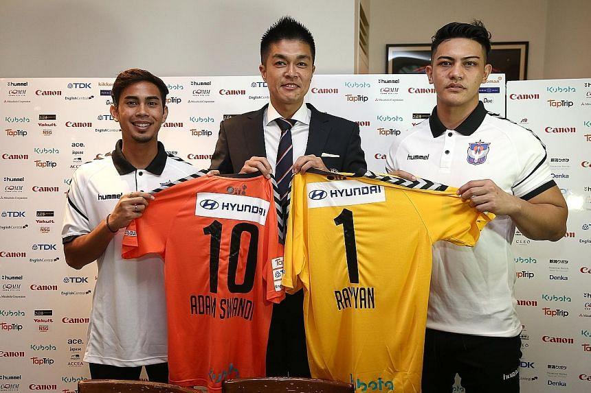 Albirex Niigata chairman Daisuke Korenaga welcoming attacking midfielder Adam Swandi and goalkeeper Shahul Rayyan.