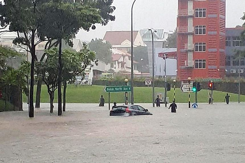 Flash floods hit nine areas in the east of Singapore yesterday morning, including the junction of Upper Changi Road and Bedok North Avenue 4.