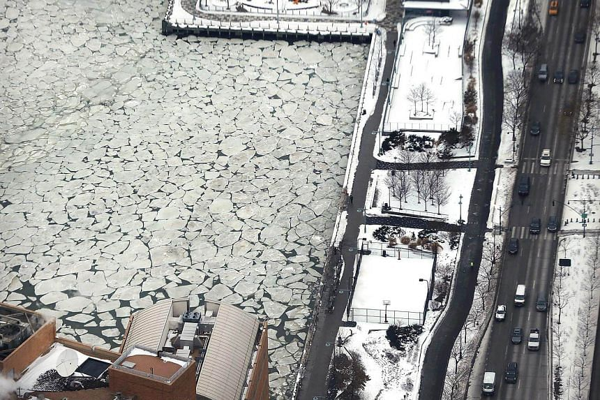 A frozen section of the Hudson River sits below the One World Observatory in New York City, on Jan 8, 2018.