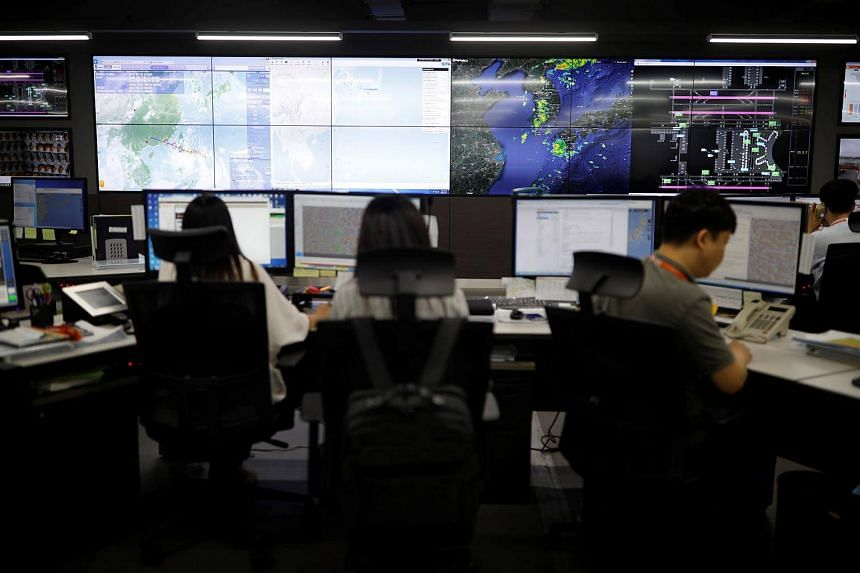 Employees work at Jeju Air's Operations Control Center at its office near Gimpo Airport in Seoul, on Aug 21, 2017.
