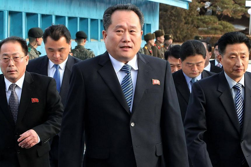 North Korean chief delegate Ri Son Gwon (centre) and his delegation cross the border line to attend an inter-Korea talks at the border truce village of Panmunjom, on Jan 9, 2018.