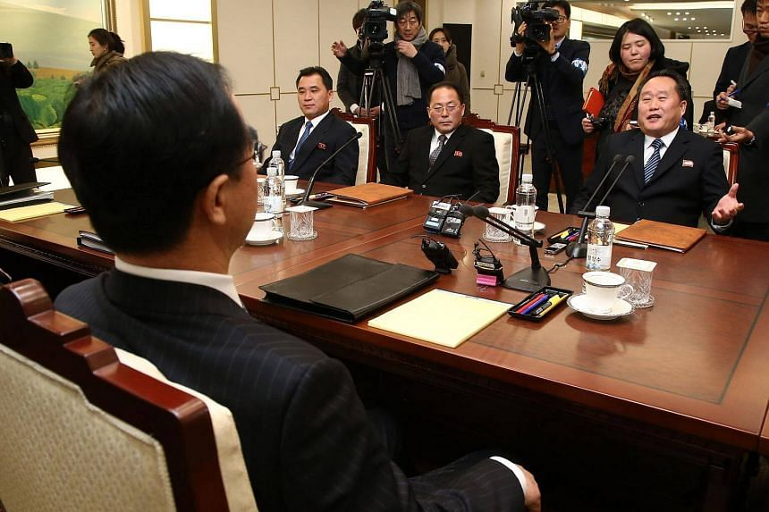 North Korean chief delegate Ri Son Gwon (right) talks with South Korea Unification Minister Cho Myung Gyun (front left) during their meeting.