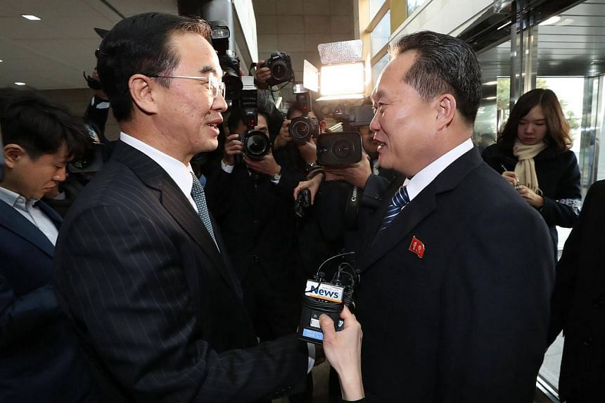 South Korea Unification Minister Cho Myung Gyun (left) greets North Korean chief delegate Ri Son Gwon before their meeting.