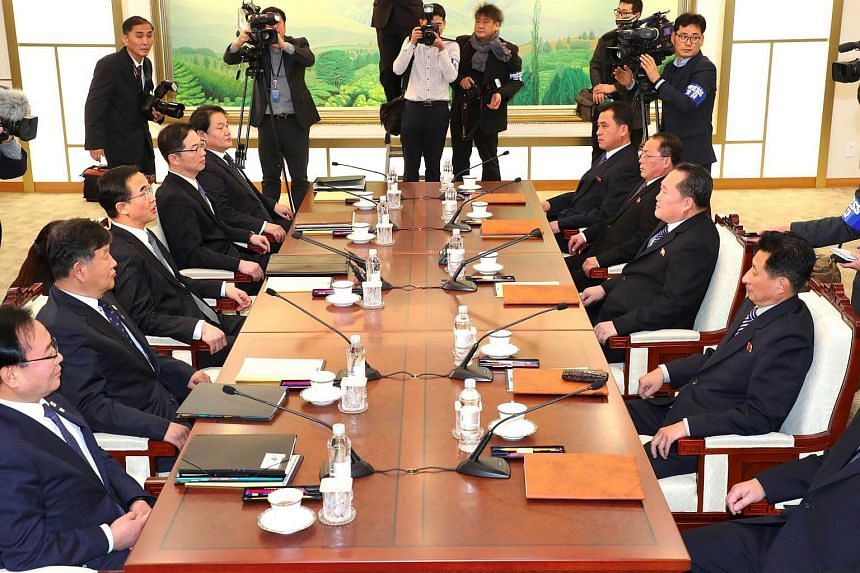 South Korea Unification Minister Cho Myung Gyun (third from left) greets North Korean chief delegate Ri Son Gwon (third from right) before their meeting.