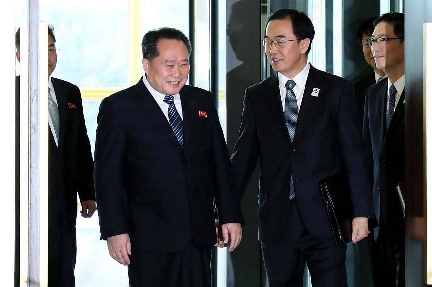 South Korea Unification Minister Cho Myung Gyun (second from right) greets North Korean chief delegate Ri Son Gwon (second from left) before their meeting.