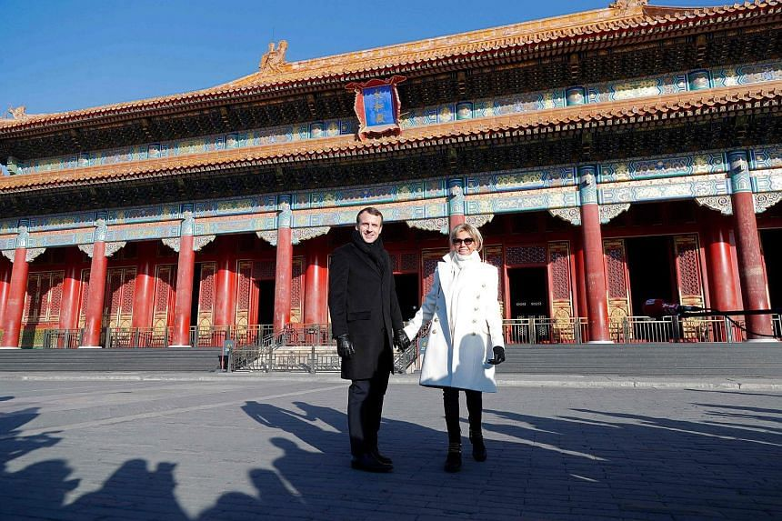 French President Emmanuel Macron and his wife Brigitte Macron visiting the Forbidden City in Beijing, on Jan 9, 2018.