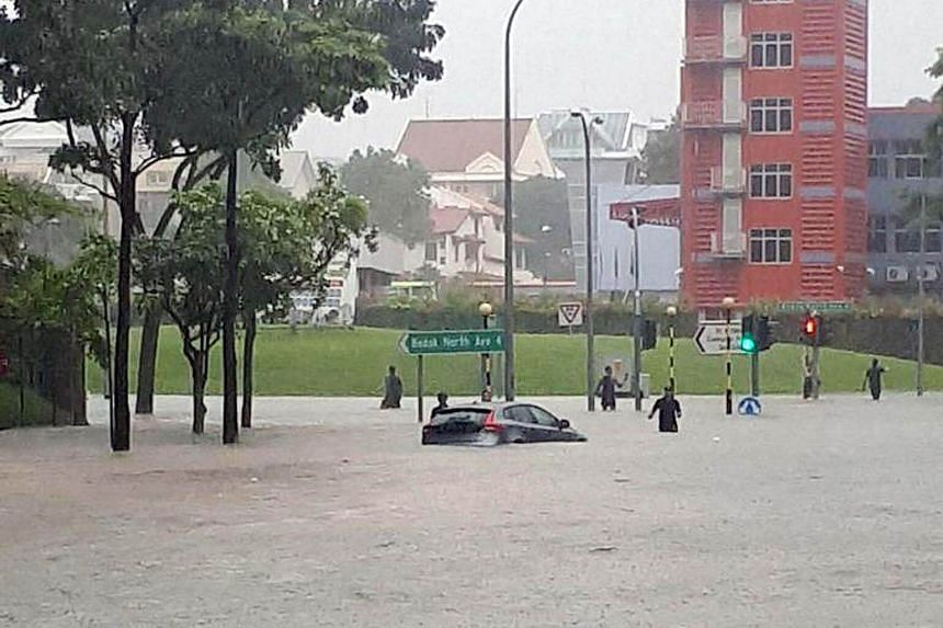 A car in the flooded road at the junction of Upper Changi and Bedok North Avenue 4.