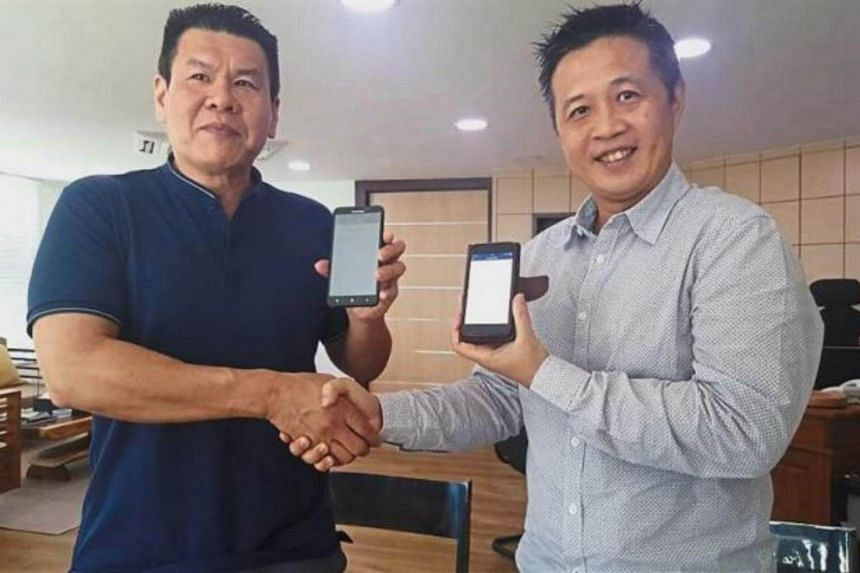 The deal, worth half a bitcoin ($12,600), was made between Alexander Yee (right), who is one of Sabah's top tourism entrepreneurs, and his friend Polycarp Chin.