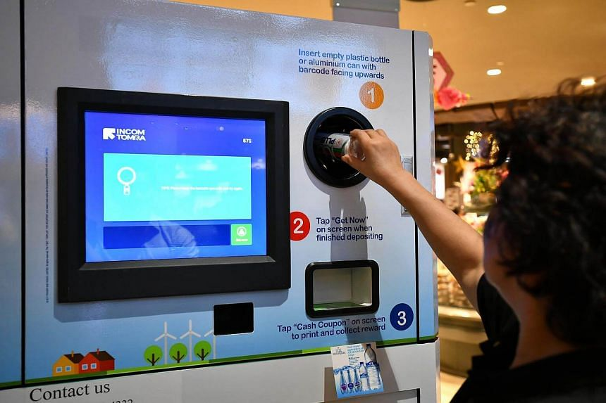 "A ""reverse vending machine"" at Waterway Point's FairPrice Finest outlet identifies, sorts, and collects used cans or bottles of drinks which are then sent to to recycling plants in neighbouring countries."