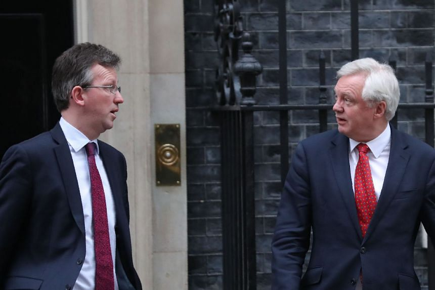 Mr Davis (right) and Britain's Attorney-General Jeremy Wright leave 10 Downing street in London on Jan 9, 2017.