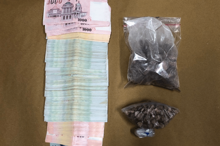 Heroin and cash recovered from a unit in Jalan Bahagia on Jan 8.