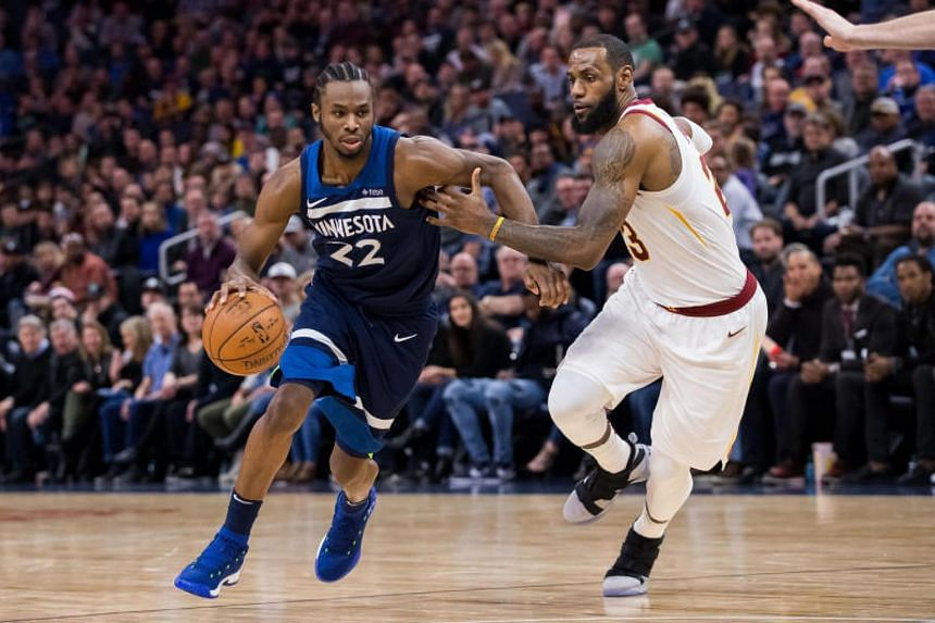 Minnesota Timberwolves guard Andrew Wiggins (#22) driving against Cleveland Cavaliers forward LeBron James during their NBA match on Jan 8, 2018.
