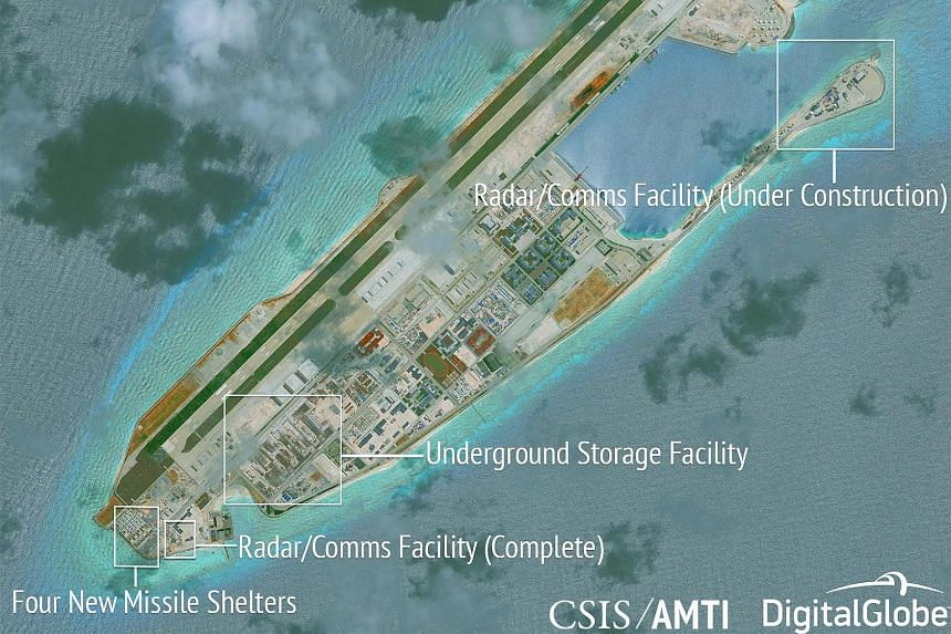 A satellite photo taken on June 16, 2017 showing construction work going on at Fiery Cross Reef, which is at the centre of a dispute between China and the Philippines.
