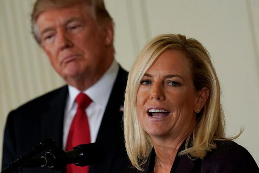 US President Donald Trump listens to his Secretary of Homeland Security nominee Kirstjen Nielsen in the East Room of the White House in Washington, US, Oct 12, 2017.