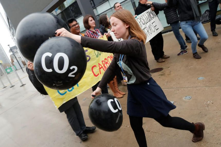 Activists protest against the carbon dioxide emissions trading in front of the World Congress Centre Bonn, the site of the COP23 UN Climate Change Conference, in Bonn, Germany, on Nov 17, 2017.
