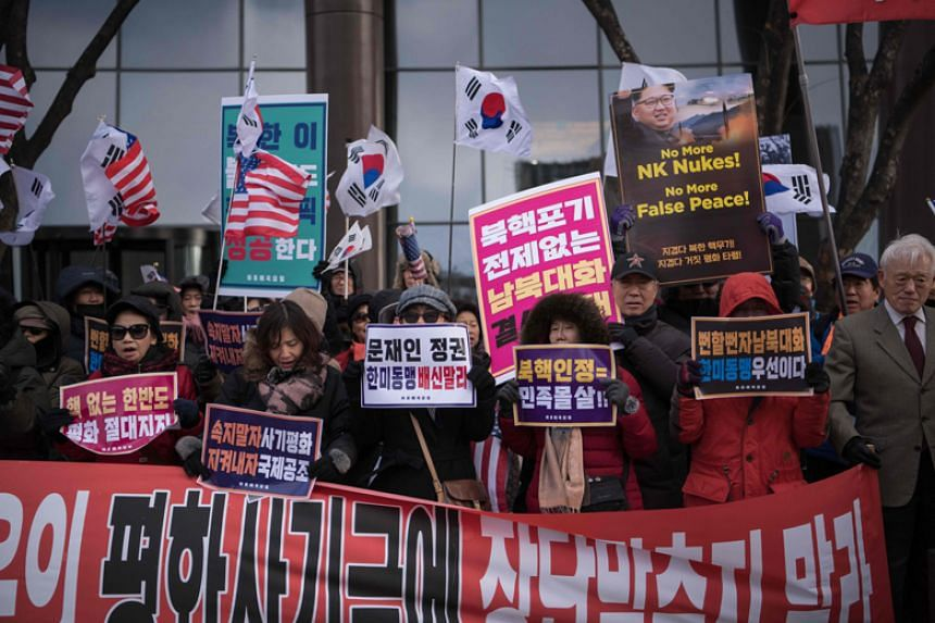 Anti-North Korea activists stage a demonstration against the inter-Korean talks in Seoul on Jan 9, 2018.