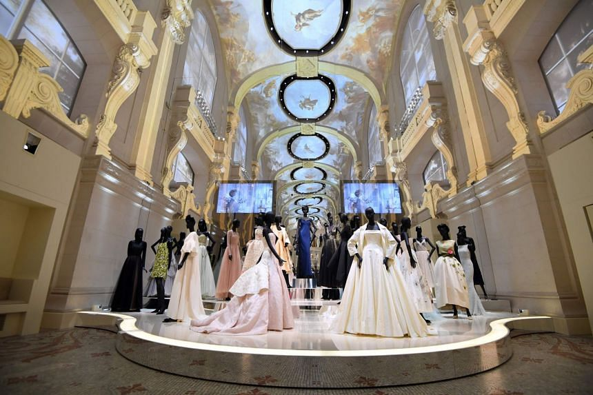 Dresses on display at the Dior exhibition that celebrates the seventieth anniversary of the Christian Dior fashion house at the Museum of Decorative Arts in Paris.