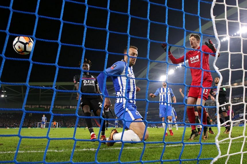 Brighton's Glenn Murray scores their second goal at the FA Cup third round between Brighton & Hove Albion and Crystal Palace at The American Express Community Stadium, Brighton, Britain on Jan 8, 2018.