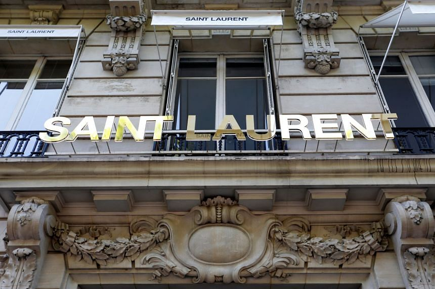 French fashion label Saint Laurent said it was partnering with Toplife, a platform launched last October by JD.com.